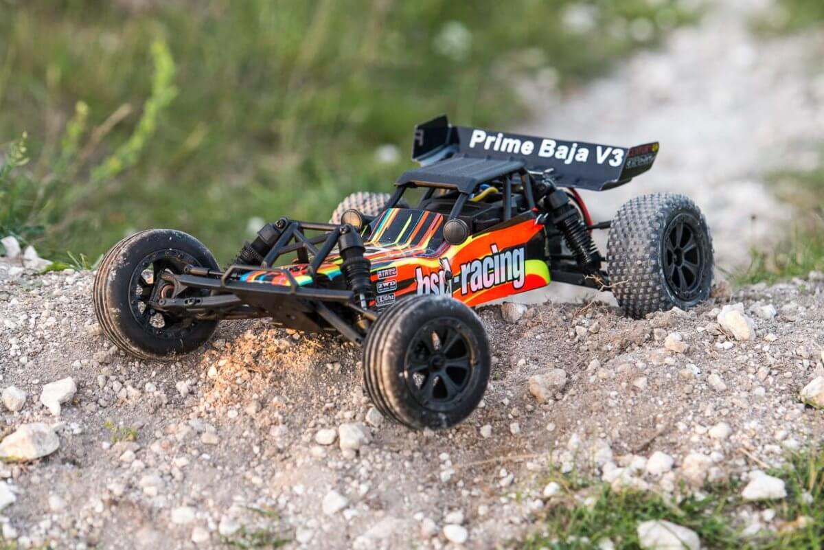 BSD Racing Prime Baja V3 Brushed Buggy black orange on a berm