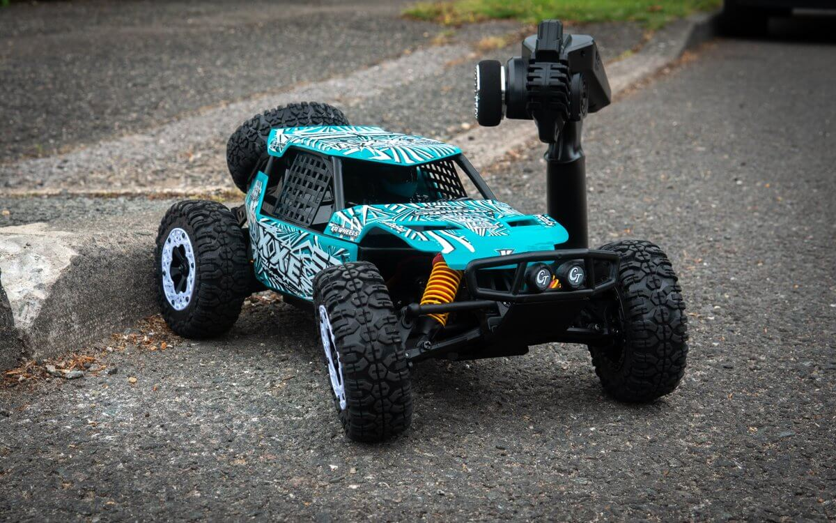 Kyosho Axxe Buggy Review Front Left With Transmitter