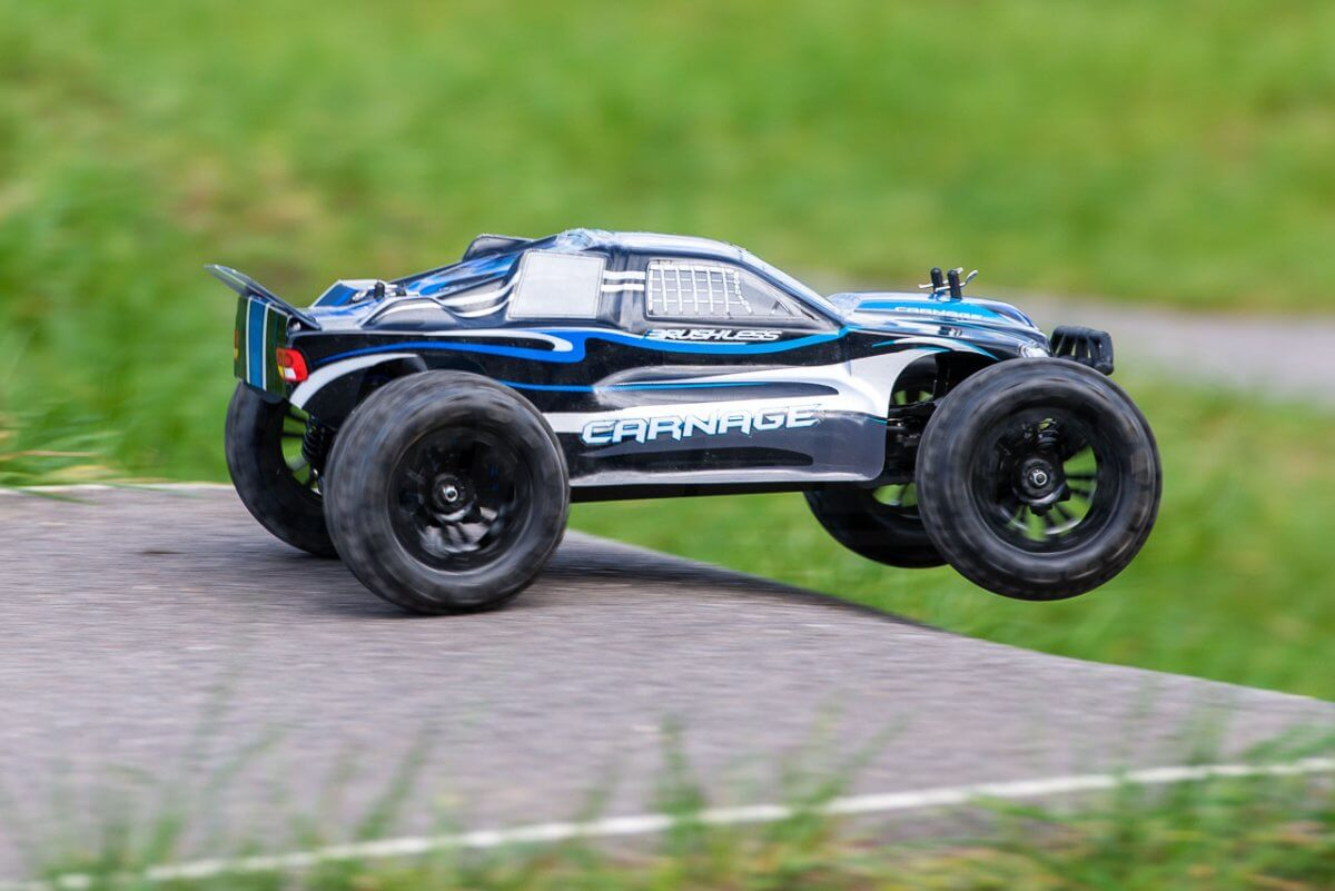 FTX Carnage Brushed versus Brushless comparison review brushless on tarmac hangtime