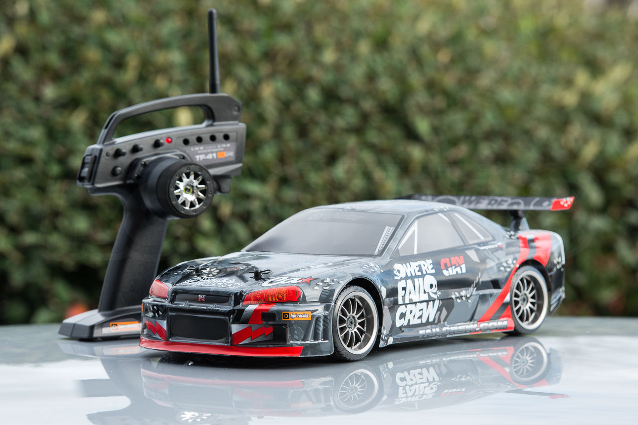 HPI Racing E10 Drift Nissan GT-R R34 Review with transmitter on reflective surface