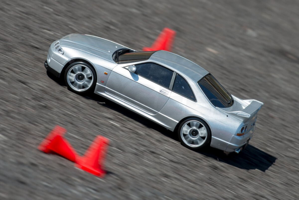 Kyosho Mini Z Drift cars review Skyline R33 driving close by cones fast angle