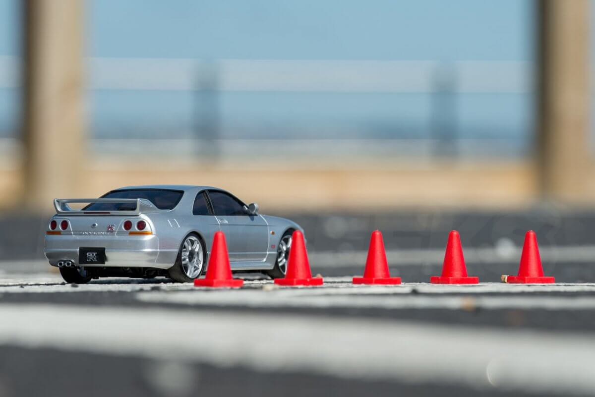 Kyosho Mini Z Drift cars review Skyline R33 parked by cones rear low wide