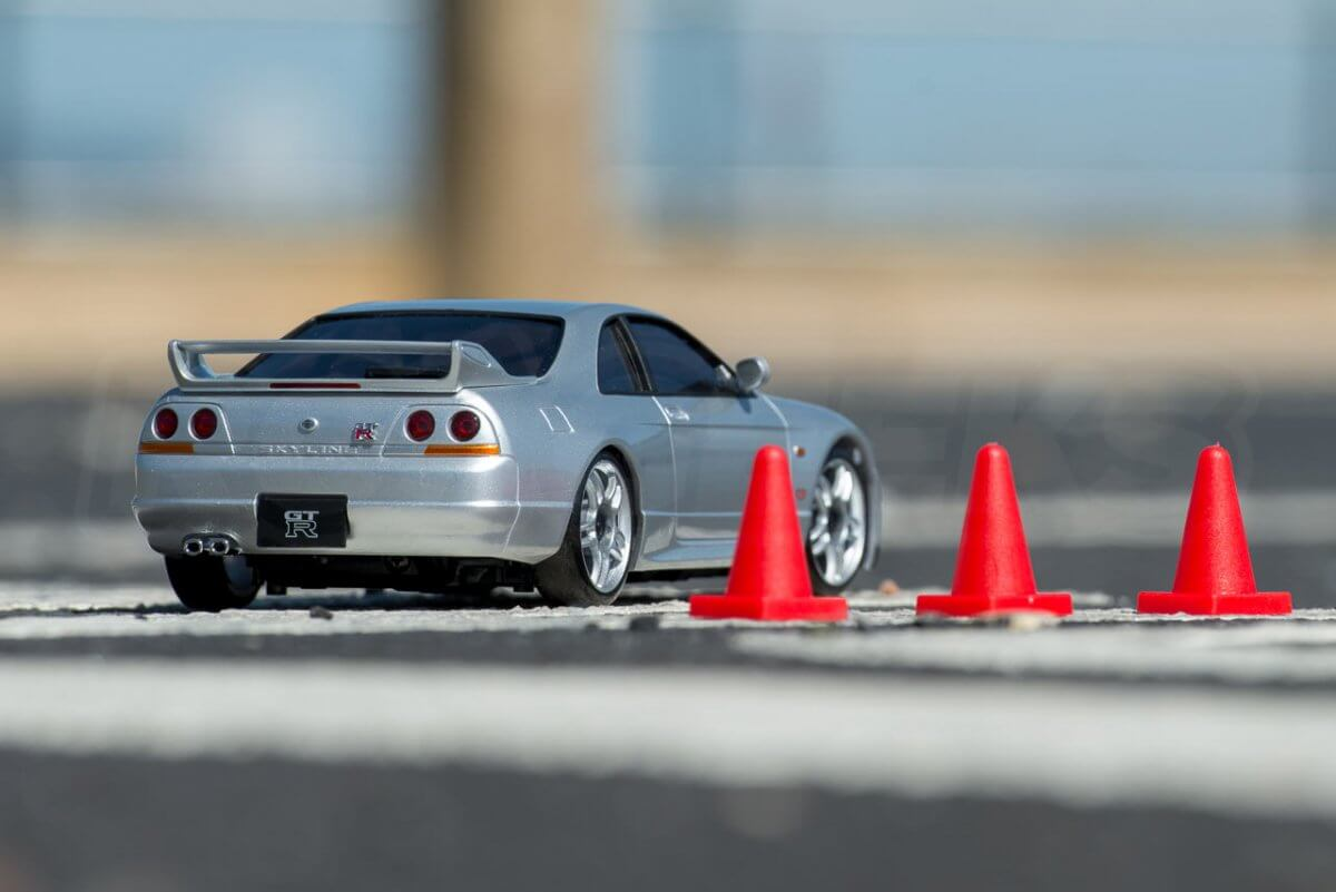 Kyosho Mini Z Drift cars review Skyline R33 parked by cones rear low