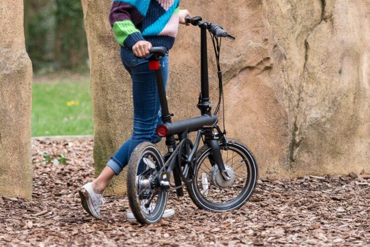 QiCycle electric folding bike by the rocks