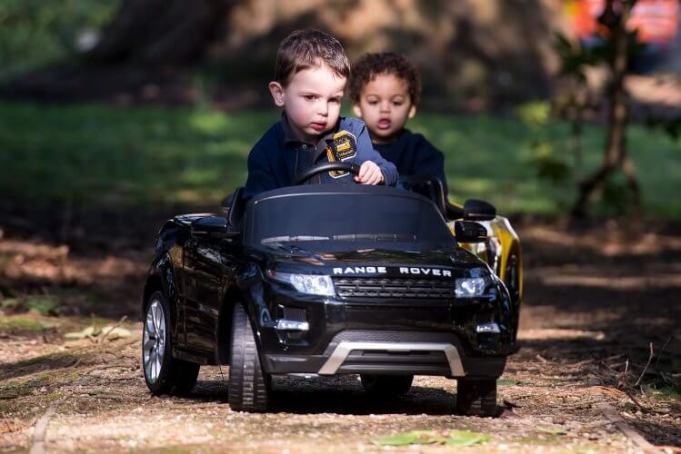 Ride On Car Range Rover Evoque Convertible Black being raced