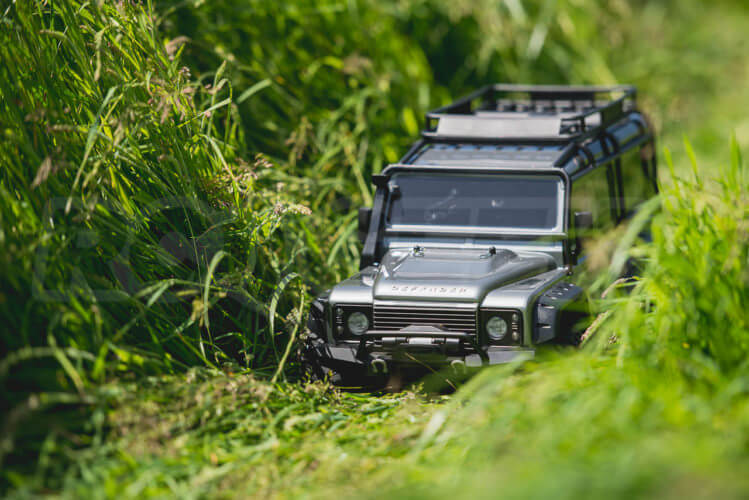 Traxxas TRX-4 Land Rover Defender deep in the grass