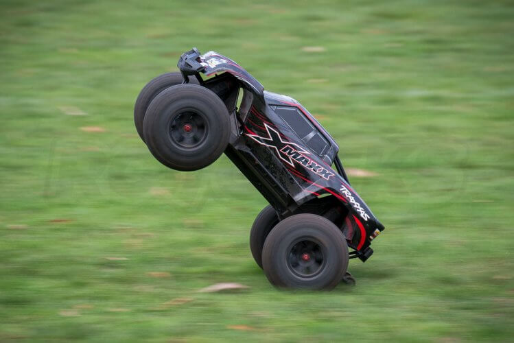 Traxxas X-maxx review red wheelie side