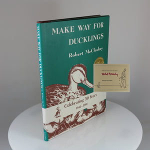 "Signed 50th Anniversary Printing of ""Make Way for Ducklings"" with its promotional band"