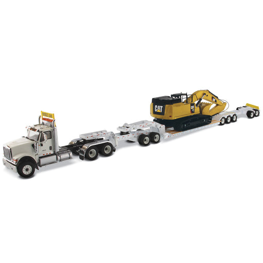 1:50 International HX520 Tandem Tractor + XL 120 Trailer outriggers, White w/ Cat349F L XE Hydraulic Excavator loaded including both rear boosters and front jeep