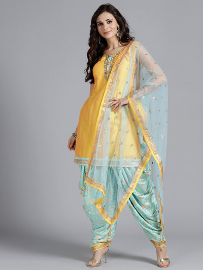 Chhabra 555 Yellow Embroidered Silk Kurta With printed Sharara and tasseled dupatta