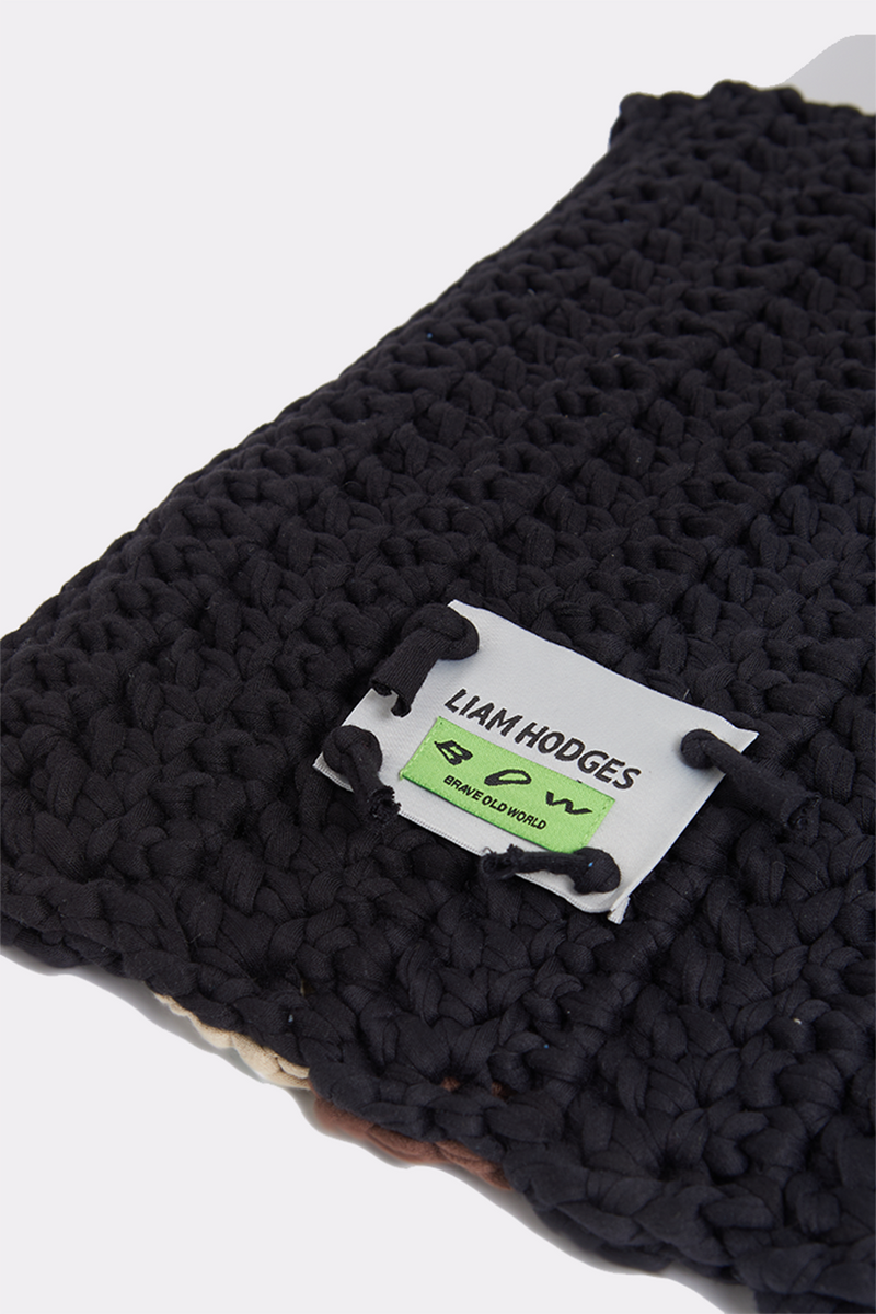 "LIAM HODGES, LIAM HODGES MENSWEAR, MADE IN THE UK, LIAM HODGES UK, LONDON DESIGNER, LONDON MENSWEAR, AUTUMN WINTER 2020, AW20, LUXURY STREETWEAR, MENS STREETWEAR, UK MENS STREETWEAR, LUXURY MENSWEAR, BOW, BOW ERA, BRAVE OLD WORLD, ACCESSORIES, LIAM HODGES CROCHET LAPTOP SLEEVE, LAPTOP, LAPTOP SLEEVE, CROCHET, 13"" LAPTOP"