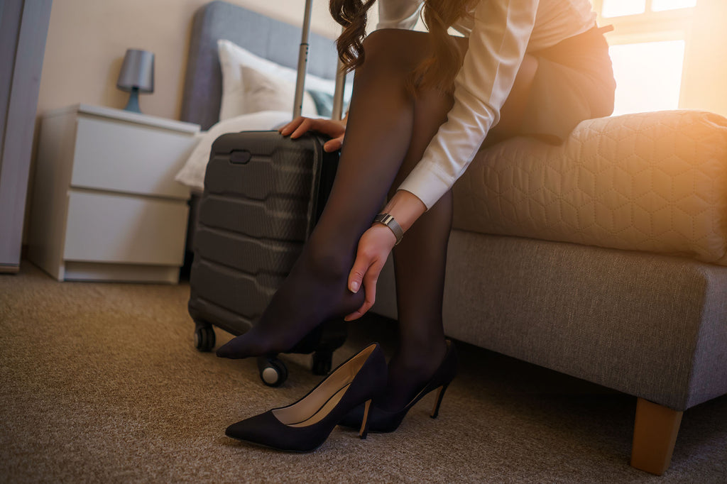 Woman wearing compression socks with heels