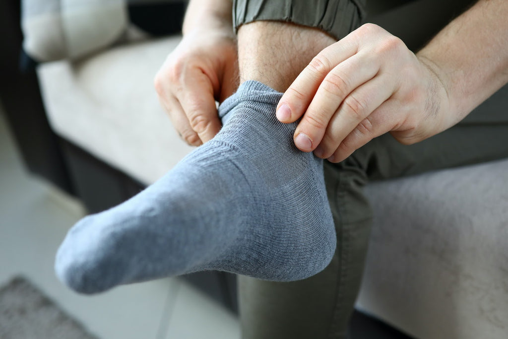 Closeup of person putting on sock