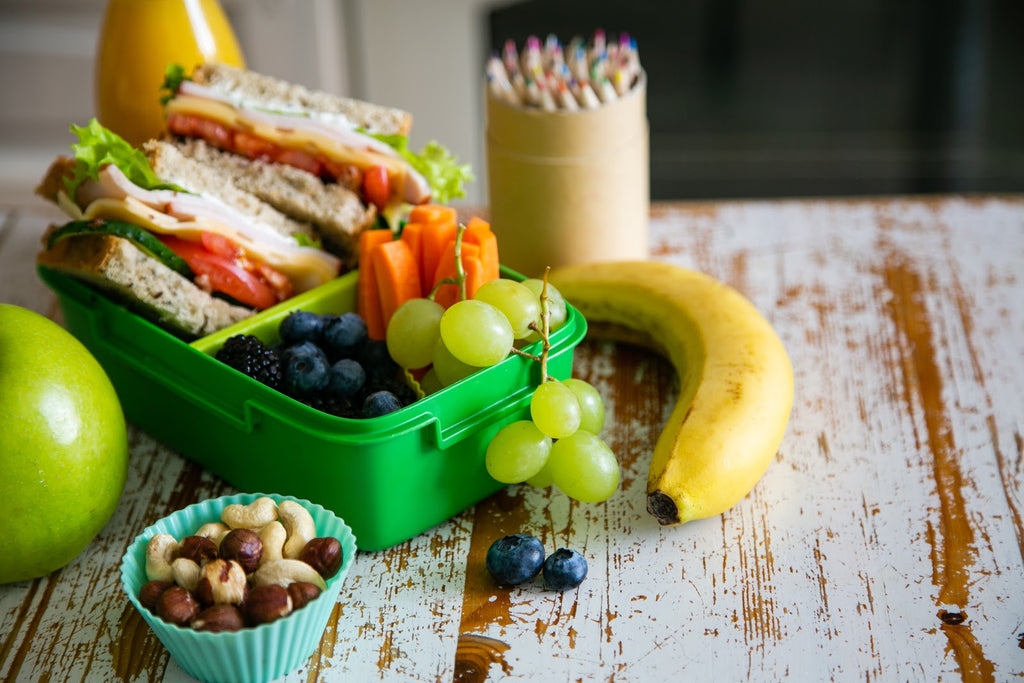 Lunchbox with fruits and nuts