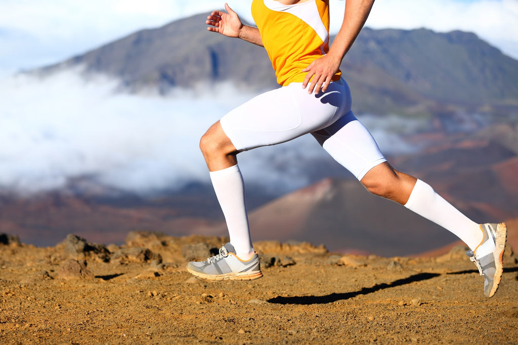 Best compression socks for men: Man running on a mountain