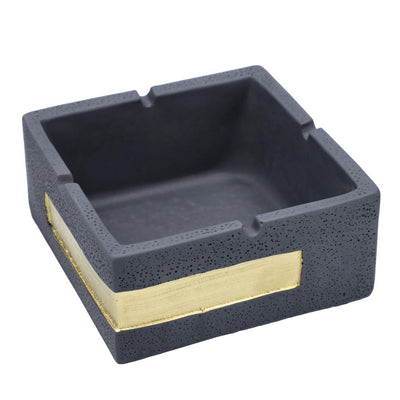"The Cement Square Ashtray has a sharp, modern design that complements any decor. It features a cement-style texture and is available in two varieties: Gray, and White.  This ashtray is 2.25"" tall and measures 5x5"" in length. It features four notched rests in the lip so you can safely park your smoke while the ash collects neatly in the tray.  The Cement Square Ashtray boasts quality and style at an affordable price. Designed for everyday use, it's both durable and easy to clean.  It merges form with functio"