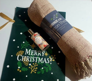 Cozy up this Christmas with this cute gift hamper.  Gift hamper contains  Home Co Cotton Throw Havana room spray Reusable Christmas bag