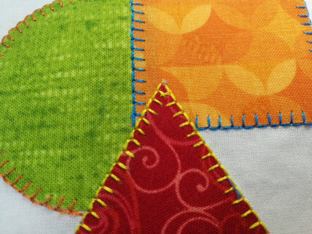 Applique (pronounced app-lee-KAY) is a French word that refers to the addition of small pieces of fabric onto a larger one to make a pattern or design by means of sewing or gluing. Quilting does not require applique, but appliqued quilts can be quite beautiful.