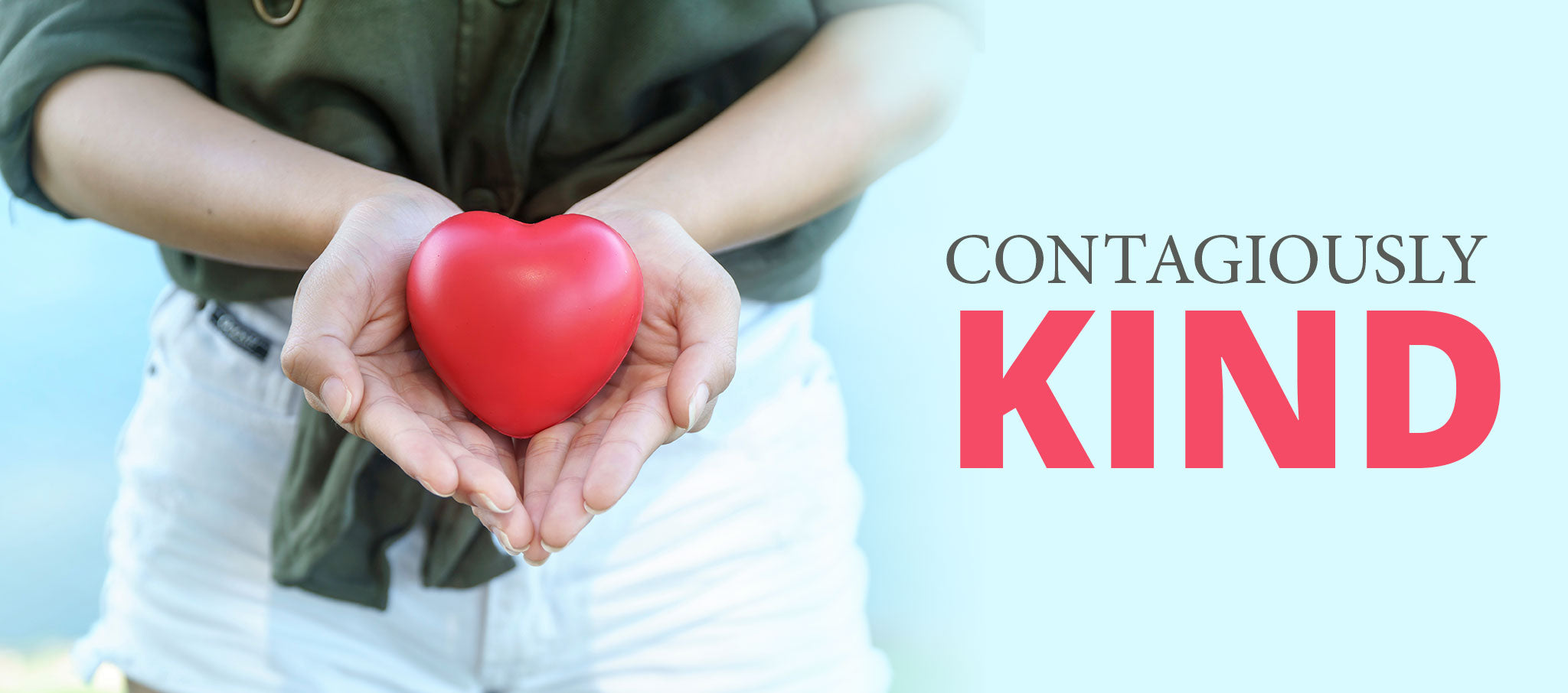 Contagiously Kind - woman holding heart