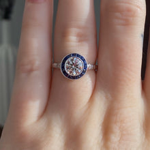 Load image into Gallery viewer, Complete Round Brilliant Engagement Ring with Sapphire Halo