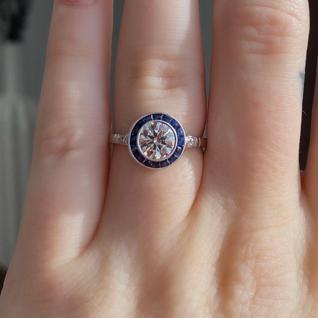 Complete Round Brilliant Engagement Ring with Sapphire Halo