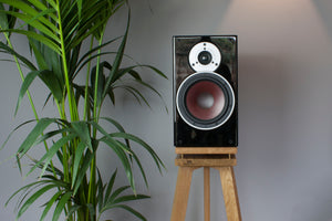 Lifestyle shot of Audio Chic Solid Oak Speaker Stand with Extra Layer of Isolation
