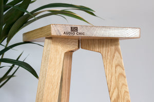 The Crane Solid Oak Speaker Stand tri-leg design.