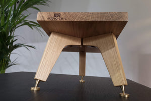 Audio Chic solid oak angled speaker stand with speaker spikes and shoes for audio enhancement.