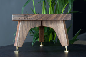 The Snipe self-levelling tri-leg speaker stand design, made from durable and strong walnut.