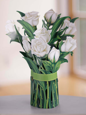 "FreshCut Paper 3D pop up ""White Roses"" measure 12"" tall by 9"" wide. Our White Roses can stand alone or be used with the accompanying vase that comes with your bouquet."