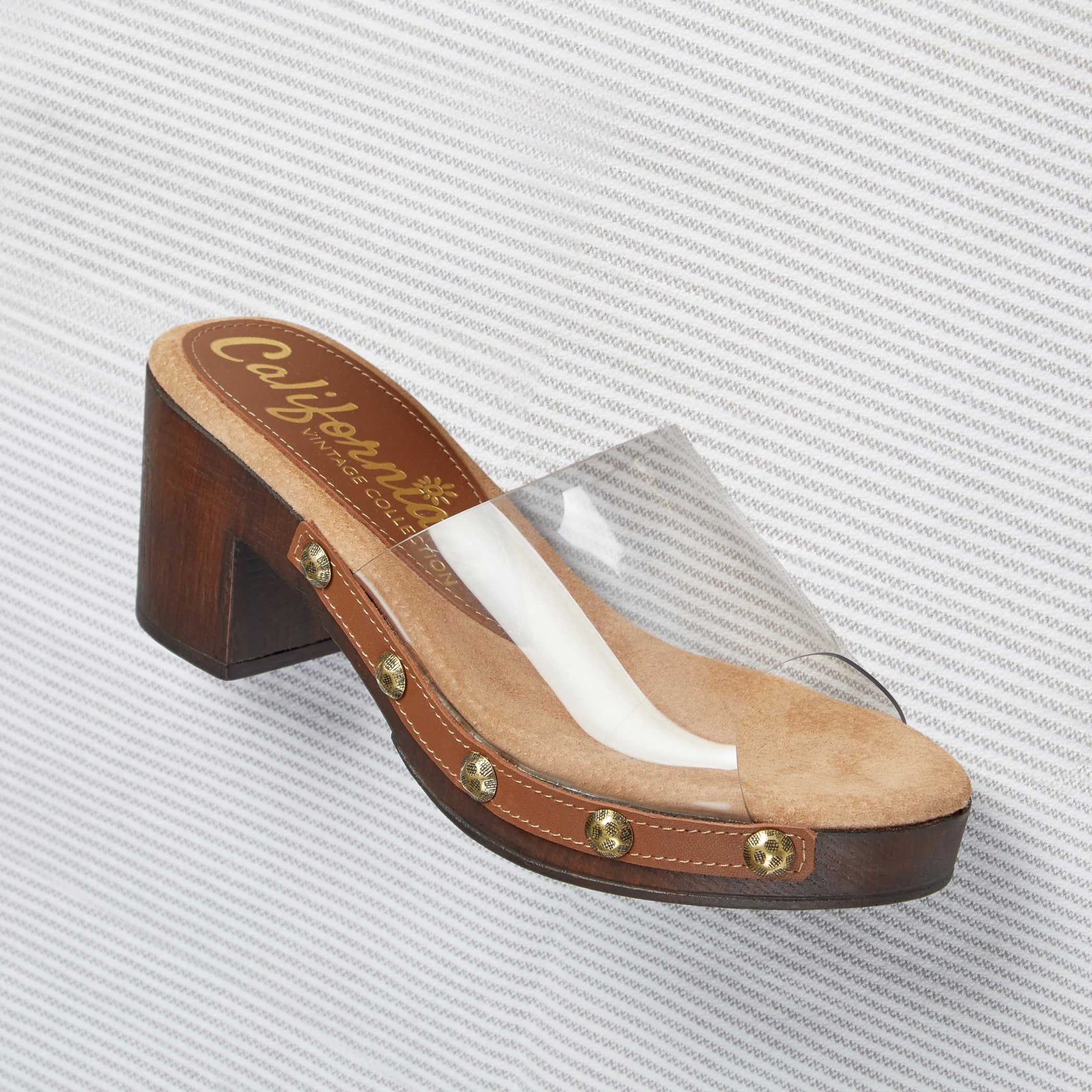 Claire low-heeled slide trimmed with studs with a clear upper