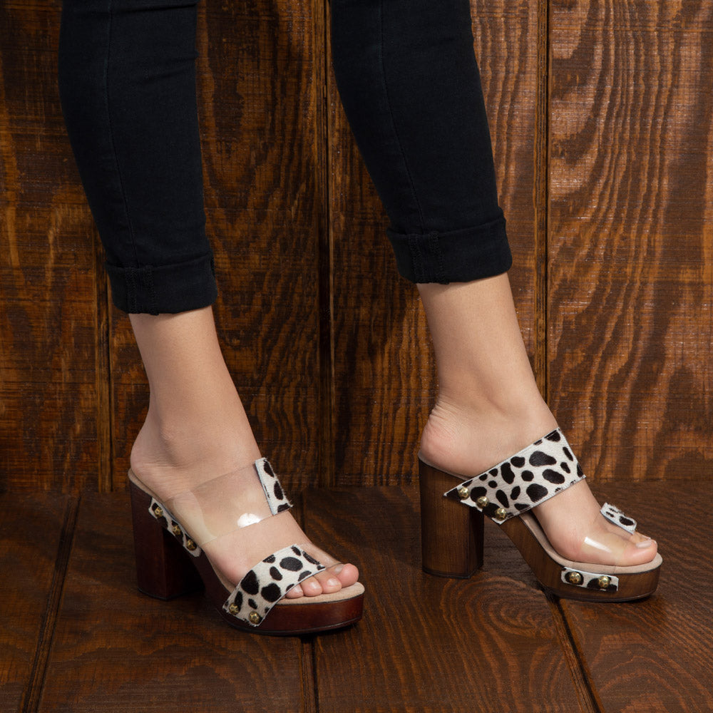 Marilyn heel features a unique 50/50 translucent and animal print two-strap upper and stud detailing