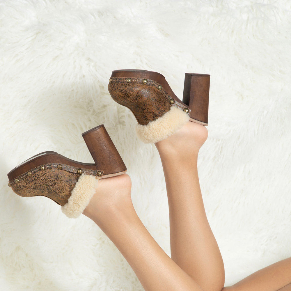 Olivia clog features a vintage distressed suede upper and a cozy genuine shearling collar.