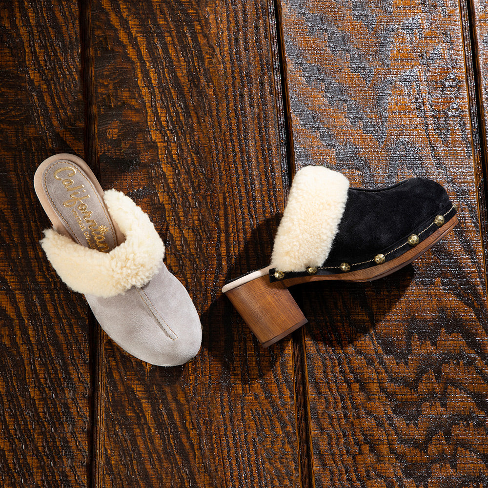 pair of greta closed-toed clogs in stone suede with fur trim