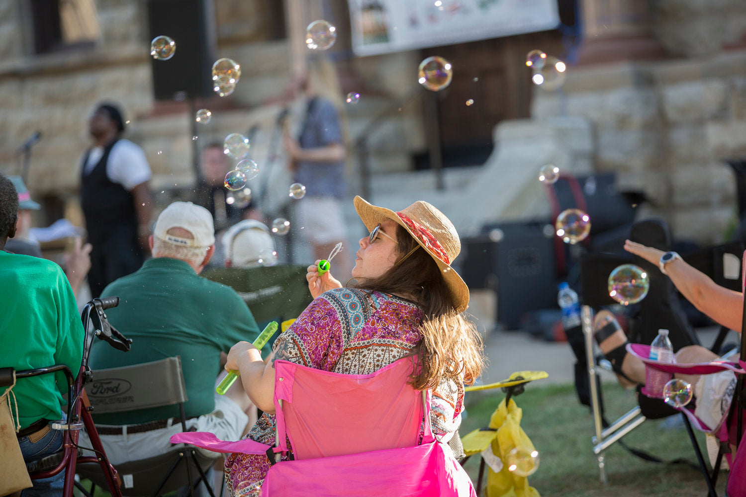 Blowing bubbles at Twilight Tunes in Downtown Denton