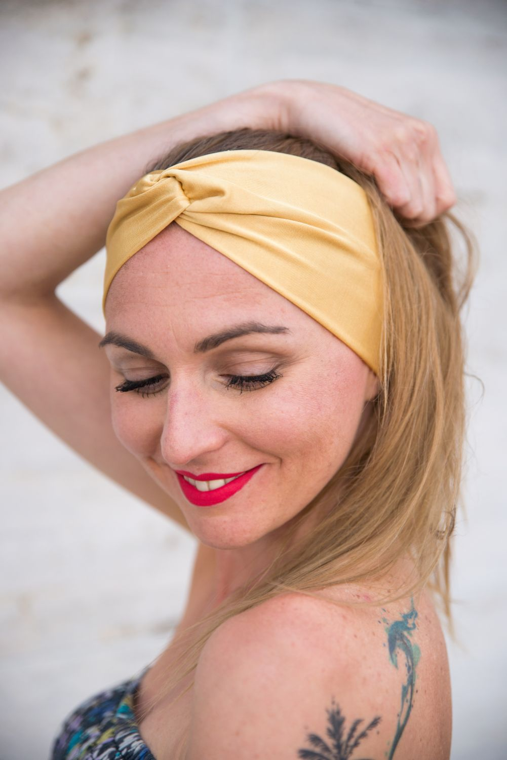 a female model's wearing a aspen gold headband