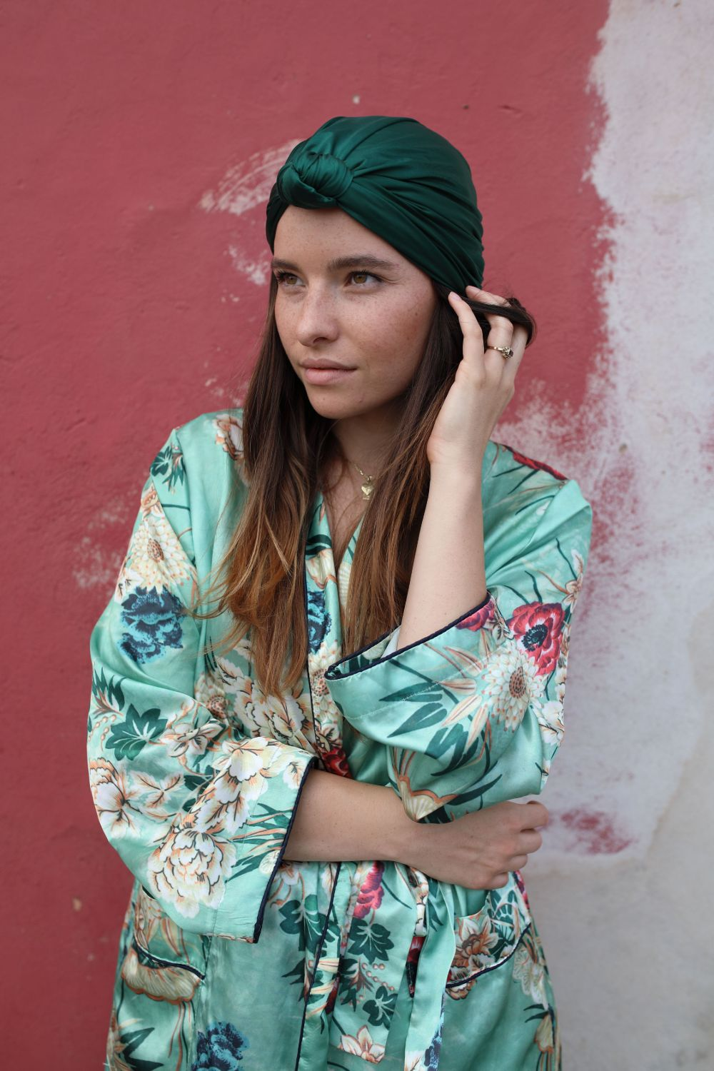 a female model is wearing a emerald green turban