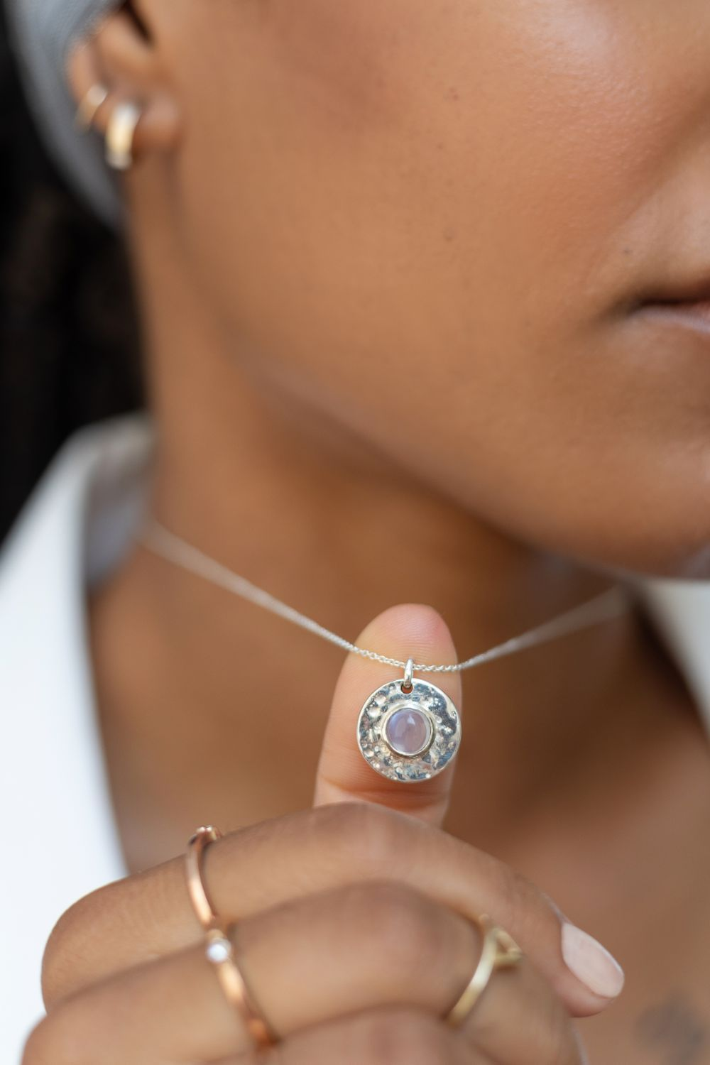 a woman's young model is wearing a Silver moonstone necklace - Cat eye
