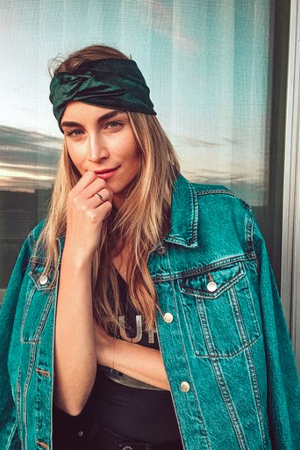 A young female model's wearing a handmade green velvet headband