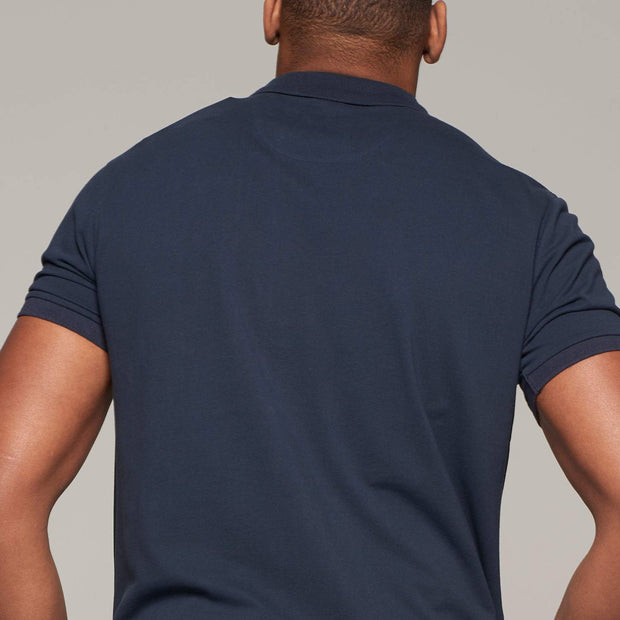 Fortmens model wearing Campione Sail polo shirt in navy blue - front view