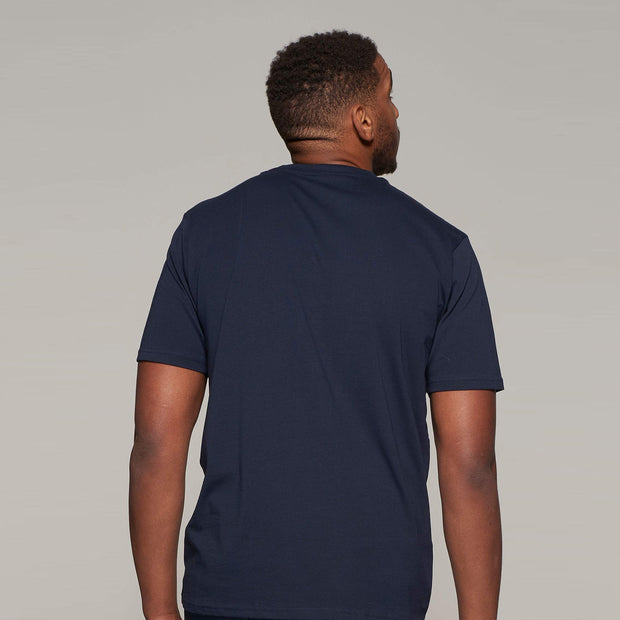 Fortmens model wearing Casa Moda printed Sunset Coast T-Shirt in Navy Blue - back view