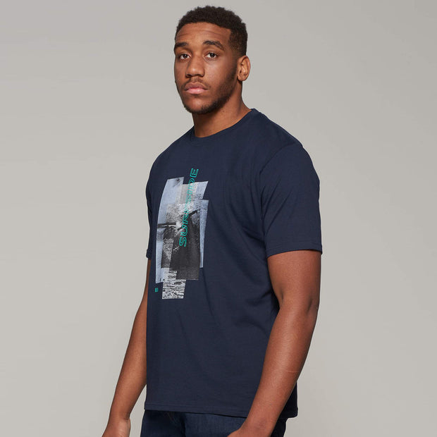 Fortmens model wearing Casa Moda printed Sunset Coast T-Shirt in Navy Blue - side view