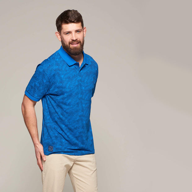 Fortmens modeling wearing North 56°4 - Allover Leaf Print Polo in Mid Blue - front view