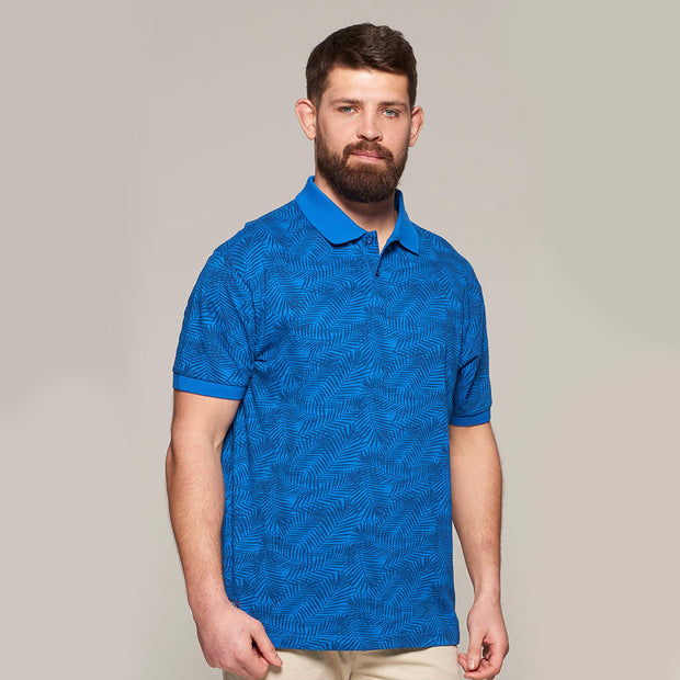 Fortmens modeling wearing North 56°4 - Allover Leaf Print Polo in Mid Blue - full nody