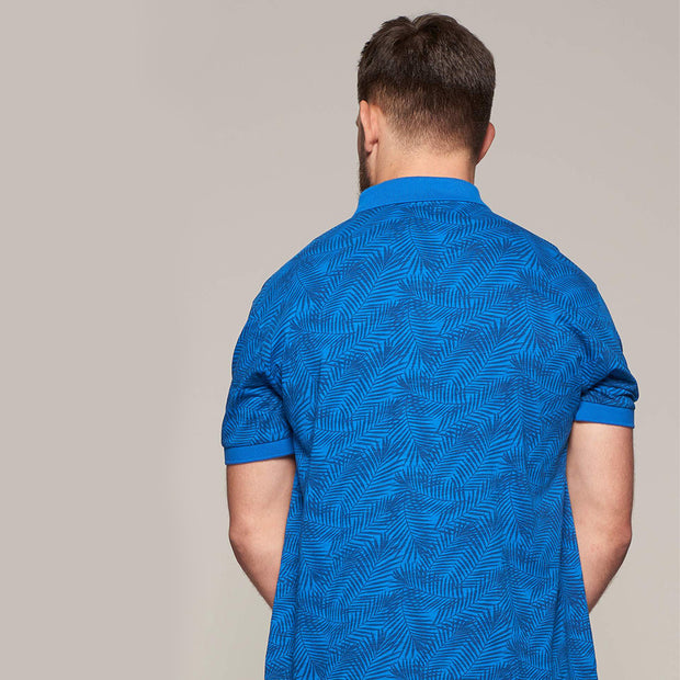 Fortmens modeling wearing North 56°4 - Allover Leaf Print Polo in Mid Blue - close up