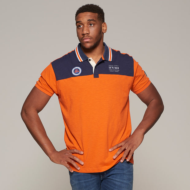 Fortmens model wearing North56 nautical contrast polo shirt in orange - front view