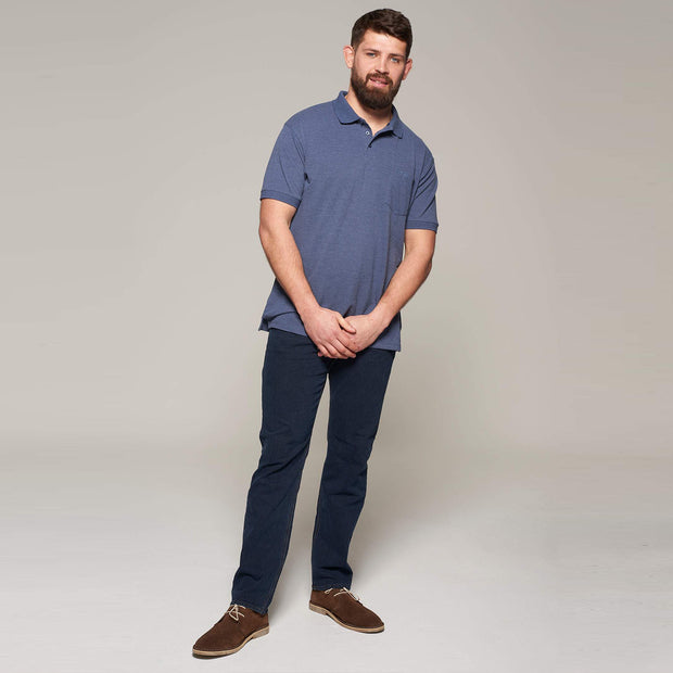 Fortmens model wearing North 56°4 polo shirt in blue with chest pocket - back view