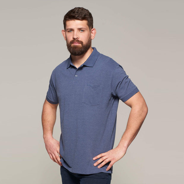 Fortmens model wearing North 56°4 polo shirt in blue with chest pocket - close up