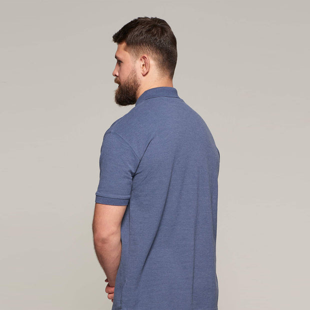 Fortmens model wearing North 56°4 polo shirt in blue with chest pocket - full body view