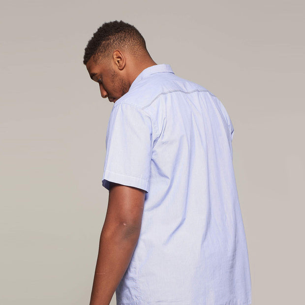 Fortmens model wearing a North 56°4 Sustainable Striped Short Sleeve Shirt in Sky Blue - back view